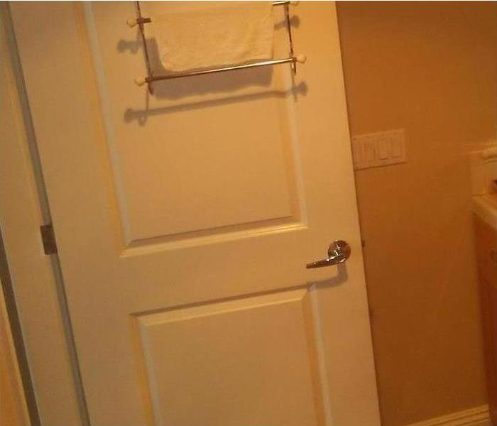 bathroom door with damage