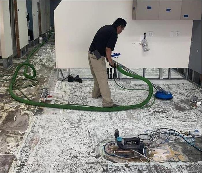 office with technician cleaning floors