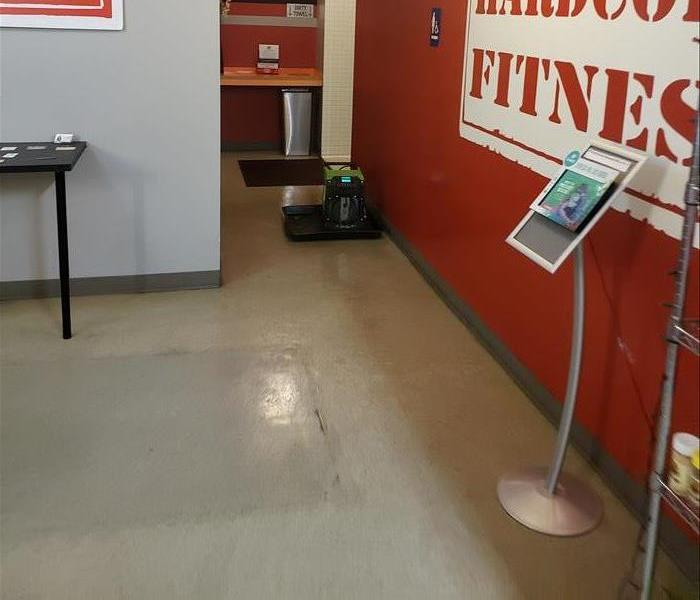 gym hallway with water damage