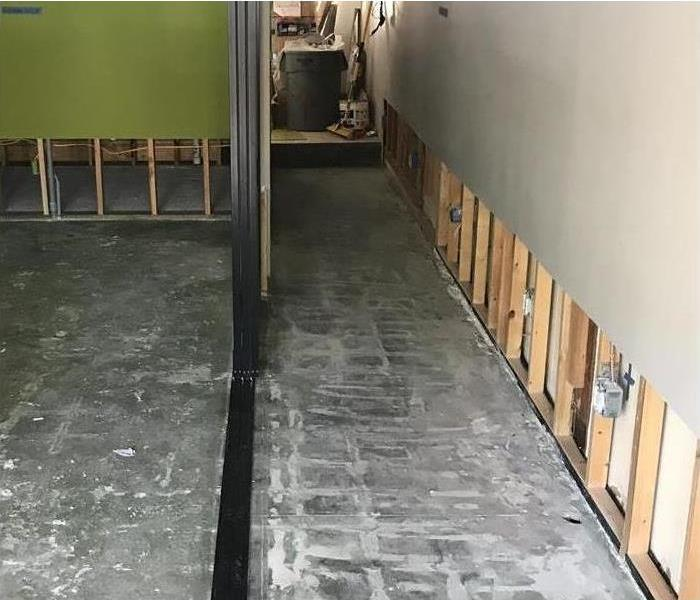 commercial hallway with sheetrock cut away