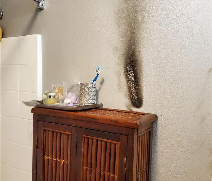 The results of a fire cause by a candle being too close to the wall of a San Diego home