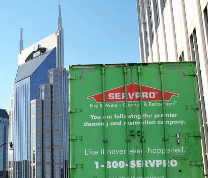 SERVPRO trailer against a city scape background