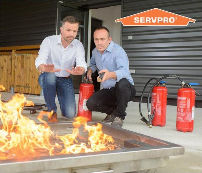 two men testing different fire extinguishers